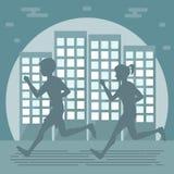 跑步在城市的夫妇 免版税库存图片