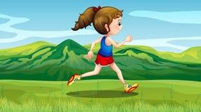 跑步在小山附近的女孩 库存照片