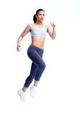 跑步的妇女。 免版税库存照片