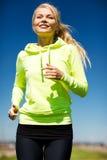 跑步的妇女户外 图库摄影