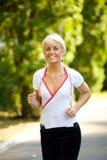跑步的妇女 免版税图库摄影