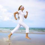 跑步的妇女 免版税库存照片
