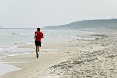 跑步的海滨 免版税库存图片