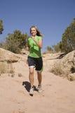 跑步的线索妇女 图库摄影