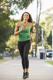 跑步的街道妇女年轻人 图库摄影