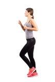 跑步的运动的妇女年轻人 免版税库存照片