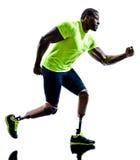 跑腿假肢的有残障的人慢跑者 图库摄影