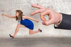 跑远离上司压力的小女实业家 免版税库存照片