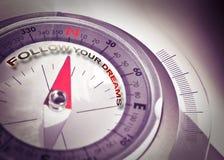 跟随您的梦想-与航行指南针的概念图象 库存图片