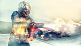 跨过终点线竟赛者,火的Kart 免版税图库摄影