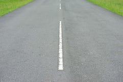 路与白色的线的沥青纹理 库存图片