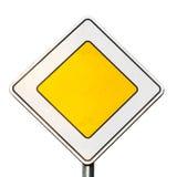 主路在白色隔绝的黄色roadsign 库存照片