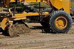 路平地机成水平在修路项目的沙子 图库摄影