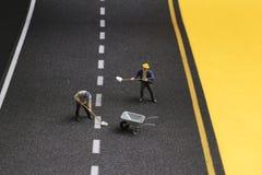 路整修过程中的宏观小雕象 库存照片
