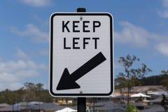 路标,保持左 图库摄影