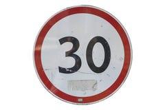 路标`限速30 km/h在白色隔绝的` 库存图片