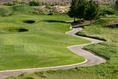 路线推进高尔夫球 免版税库存图片