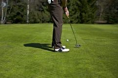 路线高尔夫球漏洞人放置 库存照片
