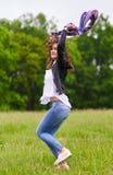 跳为喜悦的妇女 免版税库存照片