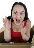 跳出从小包里边的激动的妇女 免版税库存照片