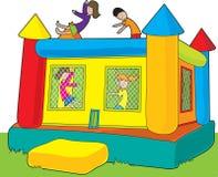 跳动城堡孩子 免版税图库摄影