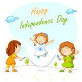 跳和庆祝印地安独立的孩子 免版税库存照片