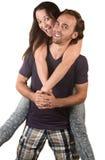 跳在丈夫的快乐的妇女 免版税库存照片