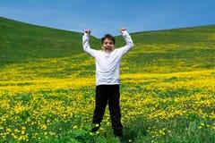 跳在草甸的男孩 库存照片