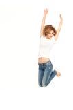 跳的妇女年轻人 免版税图库摄影