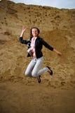 跳的成功妇女 免版税库存照片