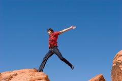 跳的红色岩石 免版税库存照片