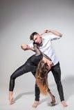 跳舞在当代窗框的两个人 库存图片