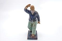 跳舞在白色背景的中国老人Taichi雕象 库存照片