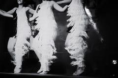 跳舞在阶段的妇女 免版税库存照片