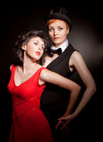 跳舞探戈的二名妇女。 一名妇女假装是人 免版税库存照片