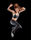 跳舞现代舞,在黑色的跃迁的妇女舞蹈家 库存图片