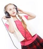 跳舞的小女孩耳机音乐唱歌 免版税图库摄影