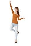 跳舞的愉快的妇女 库存照片