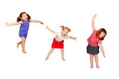 跳舞的愉快的孩子 查出在白色 免版税库存照片