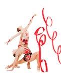 跳舞的灵活的体操运动员红色丝带二 免版税库存图片
