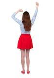 跳舞年轻美丽的妇女后面看法  库存照片