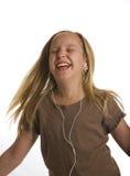 跳舞earbuds女孩佩带 免版税库存照片