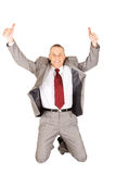 跳跃与好标志的激动的商人 图库摄影