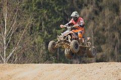 跳跃与方形字体摩托车 免版税库存图片