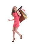 跳跃为喜悦的女售货员 免版税库存图片