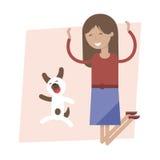 跳跃为喜悦的女孩和狗 免版税库存图片
