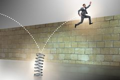 跳跃从在企业概念的春天的商人 免版税图库摄影