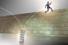 跳跃从在企业概念的春天的商人 免版税库存图片