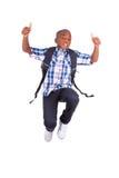 跳跃和做赞许-黑色的非裔美国人的男生 图库摄影