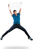 跳跃和拿着白纸的少年男孩 免版税图库摄影